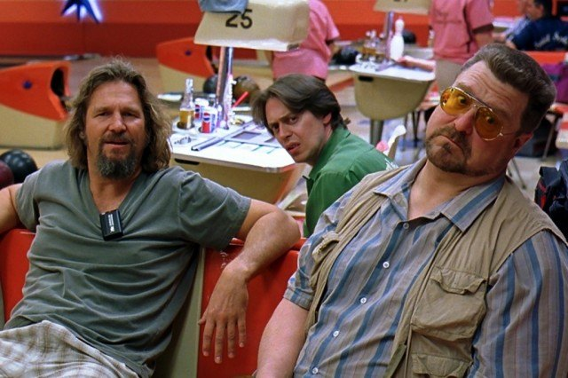 Lebowski and Donny look confused during a game of bowling in 'The Big Lebowski'