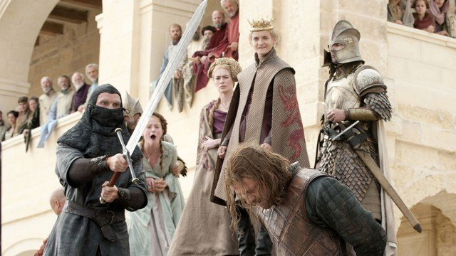 Ned Stark with his head down, about to get beheaded by a giant sword