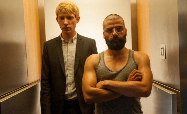Domhnall Gleeson and Oscar Isaac in a scene from the sci-fi thriller 'Ex Machina'