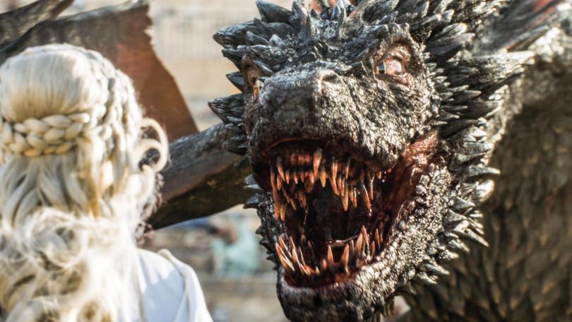 Daenerys Targaryen looks at her dragon.