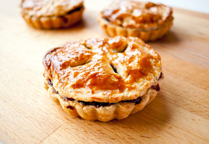 three mini pies with fluted edges and vented top crust