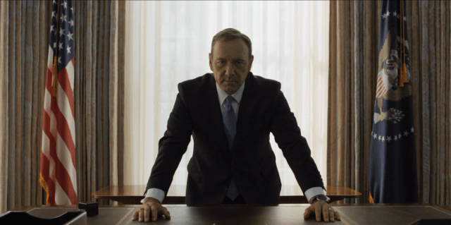 Frank Underwood leans on his desk.