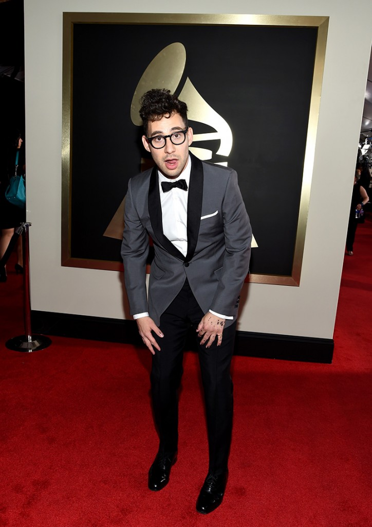 Jack Antonoff posing in a grewy jacket and black pants at the 2016 Grammy Awards