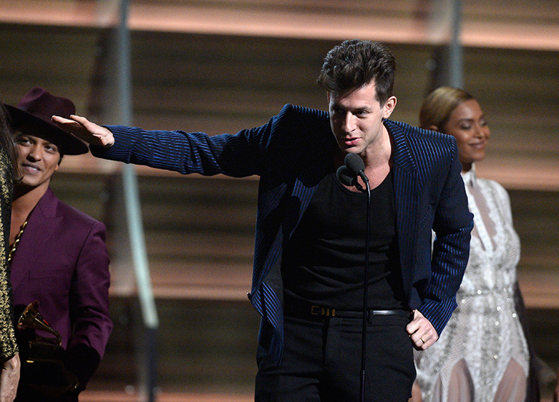 Mark Ronson onstage at the 2016 Grammy awards wearing a blue and black striped suit