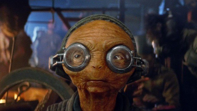 Maz Kanata stares straight ahead with a blank expression on her face.