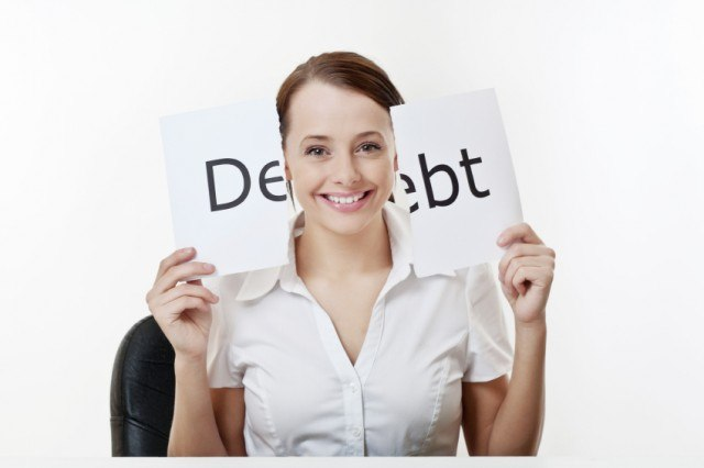 Woman holding debt sign.