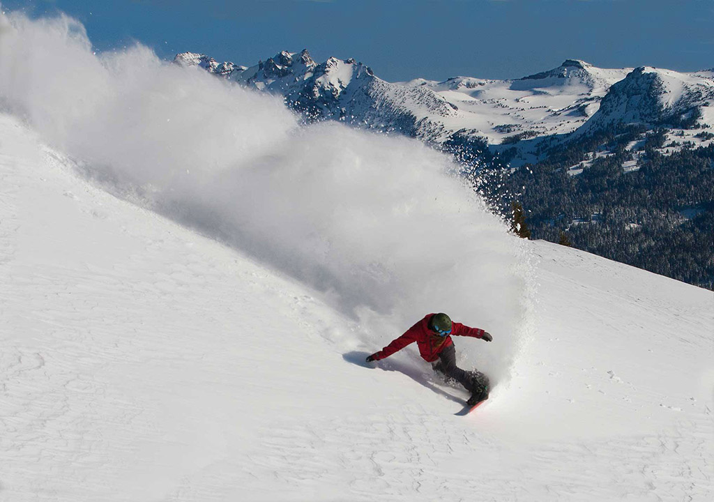a snowboarder coming down the mountain at Mt. Bachelor in Bend, Oregon
