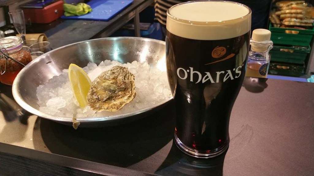 a raw oyster paired with O'Hara's Irish Stout