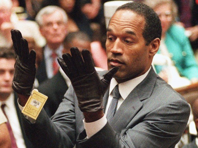 O.J. Simpson wearing a pair of black gloves during his 1995 criminal trial.