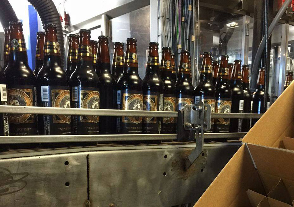 bottles of North Coast Brewing's Old Rasputin stout being produced