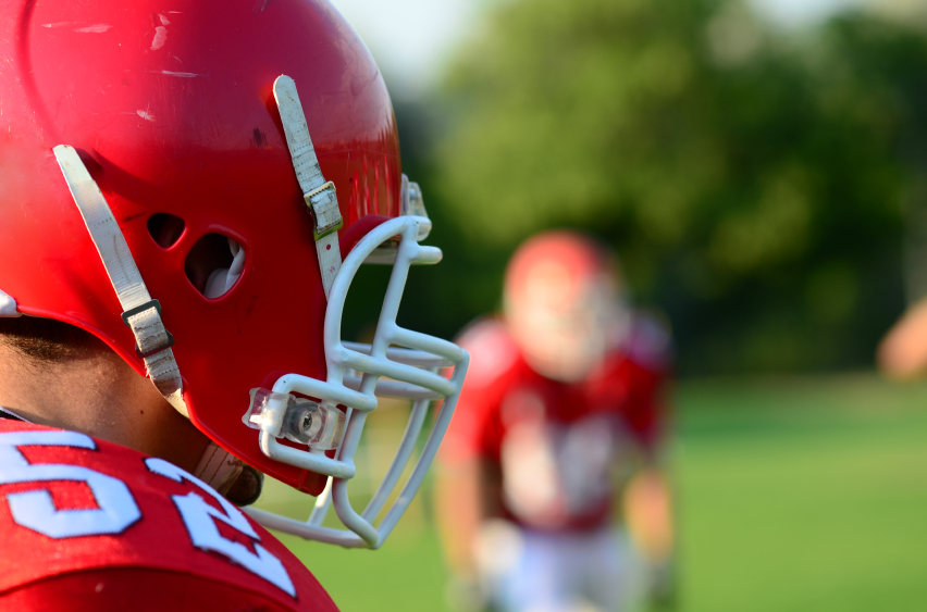 football player wearing a red helmet and jersey