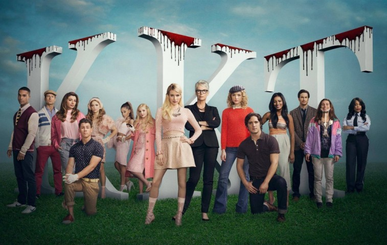 The cast of Scream Queens pose in front of sorority letters