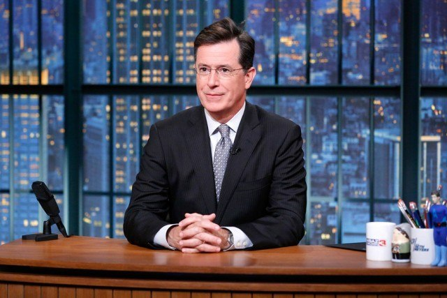 Stephen Colbert at desk.