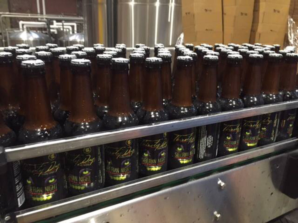 production line of siberian night stout being produced at Thirsty Dog Brewing