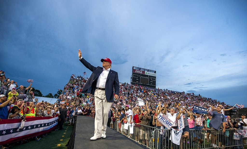 Donald Trump walking toward the stage at a rally