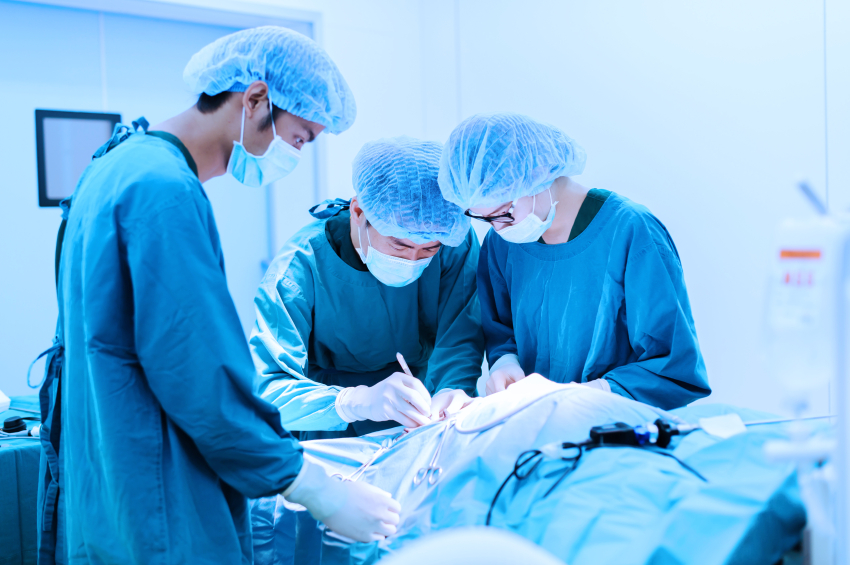 surgeons in middle of a surgical operation