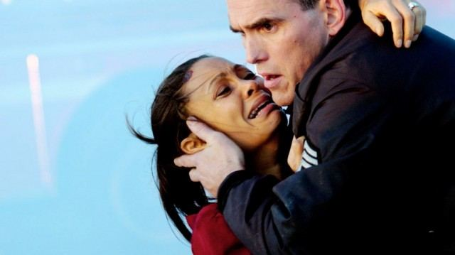 Christine crying in Officer Ryan's arms in Crash