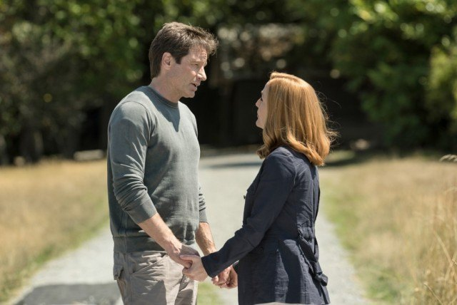 David Duchovny holds the hands of Gillian Anderson in the X-Files