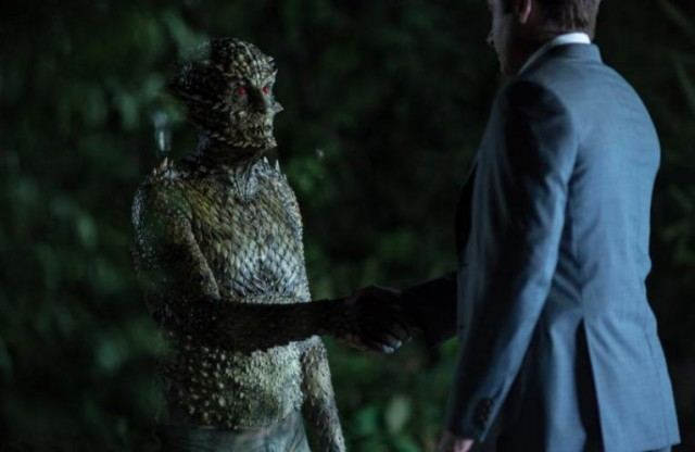 Fox Mulder (David Duchovny) shakes hand with the Were-Monster in 'The X-Files'