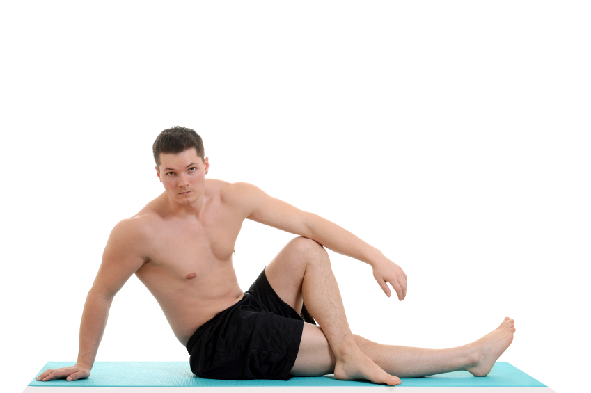 young man exercising on mat