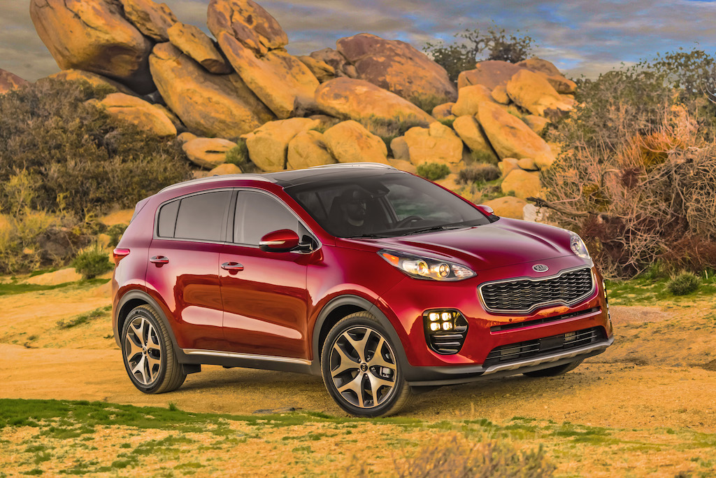 Red Kia Sportage off-roading.
