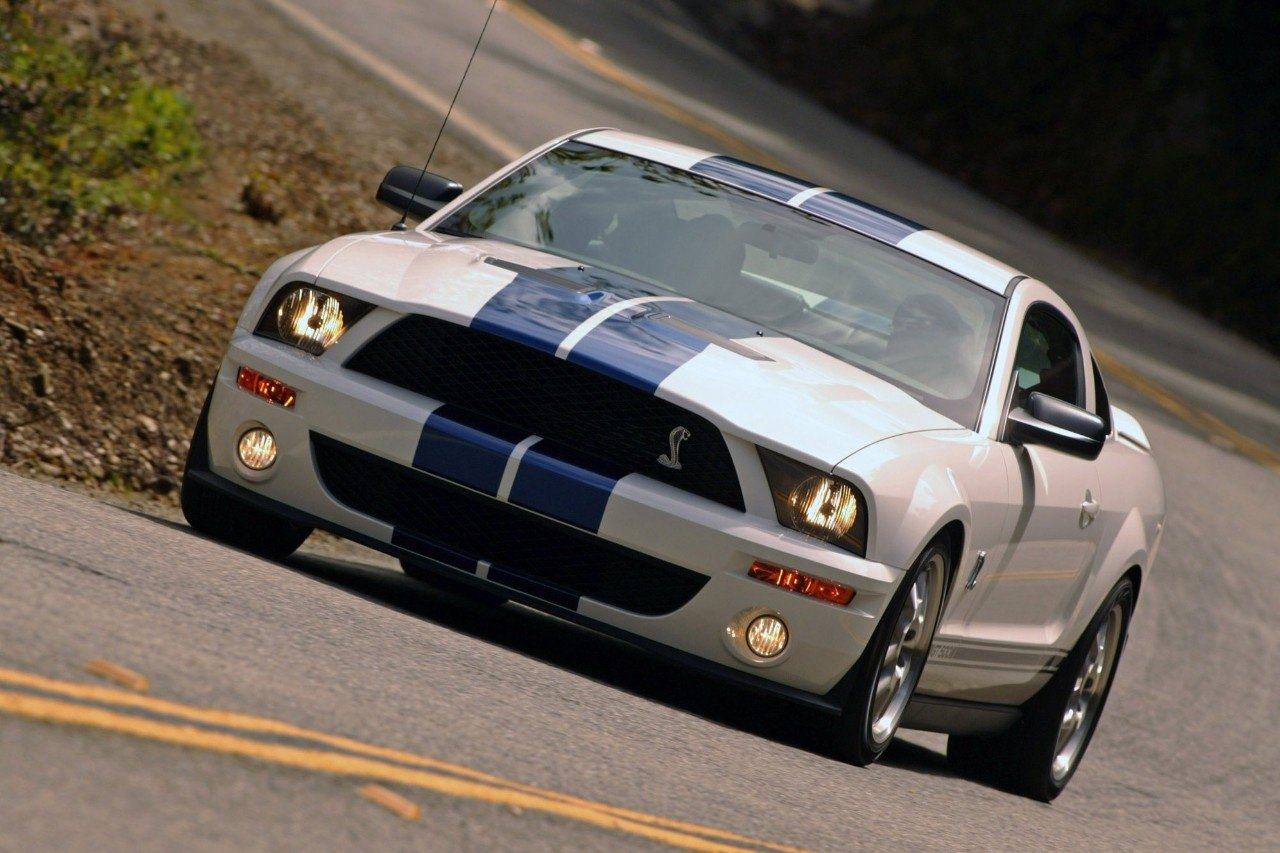 View of 2007 Shelby GT500 in white with blue racing stripes