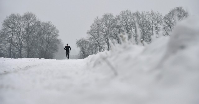 Man running in snow