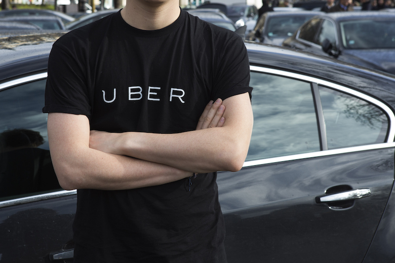 man wearing an Uber shirt