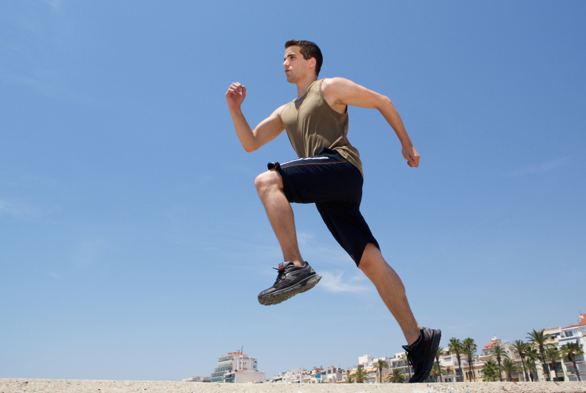 athlete warms up for exercise with high-knee skips