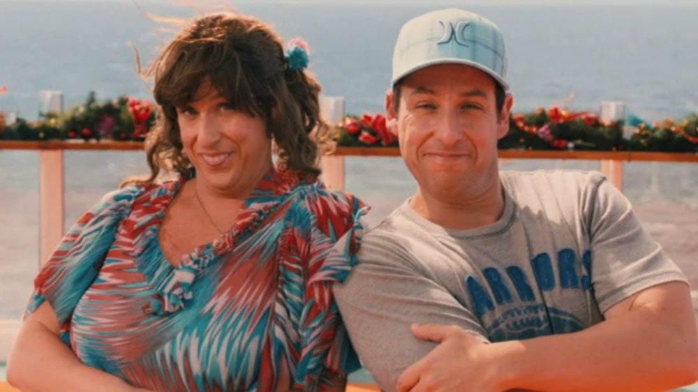 Adam Sandler as Jack and Jill is sitting next to each other smiling