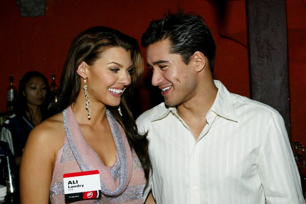 Mario Lopez and Ali Landry smiling at each other