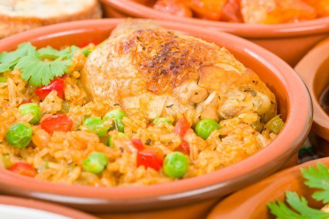 Cuban chicken and rice, arroz con pollo, with bell peppers and peas