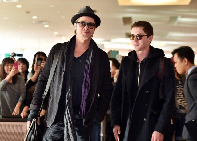 Brad Pitt and Logan Lerman arrive at Haneda airport in Tokyo