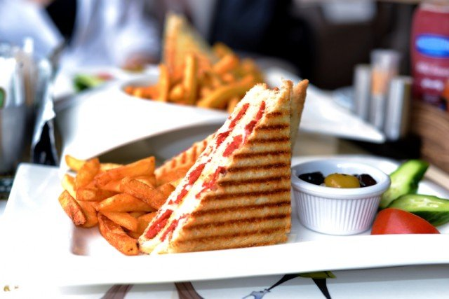 grilled cheese sandwich with pepperoni or other sausage cut in half and served with with french fries