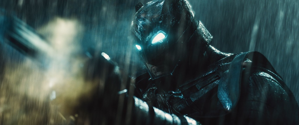 Ben Affleck's Batman with his eyes lit up in the rain as he prepares for battle in Batman v Superman: Dawn of Justice