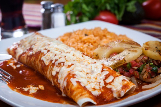 cheesy chicken enchiladas with red enchilada sauce