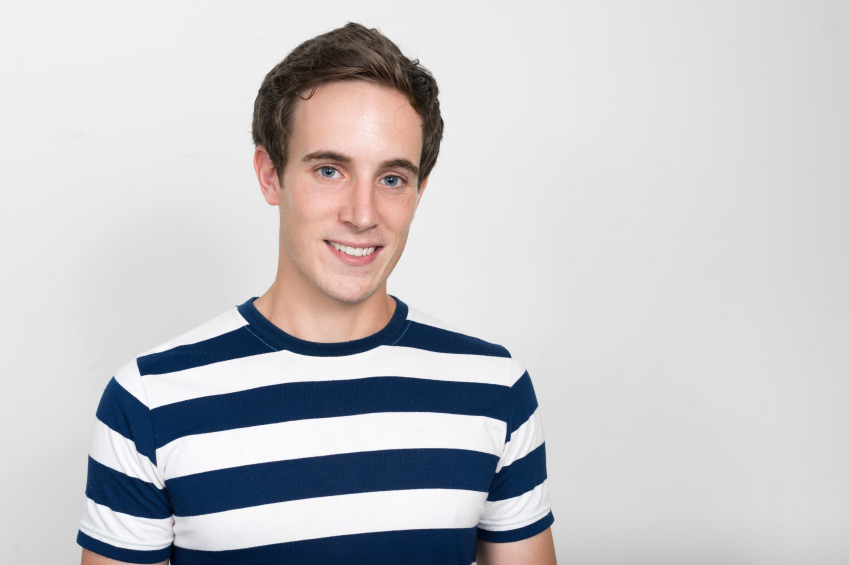 young man wearing stripped t-shirt and smilling