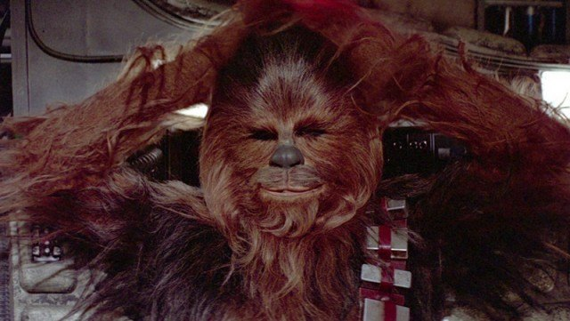 Chewbacca holding his head and closing his eyes.