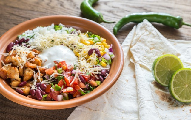 Chicken burrito bowl with rice, salsa, corn, and beans