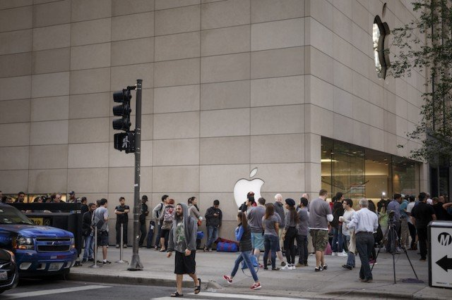 Customers outside of an Apple store, one of the places you can buy the iPhone SE