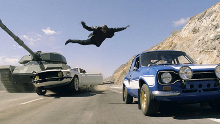 Man flies through the air toward a moving car in Fast & Furious 6