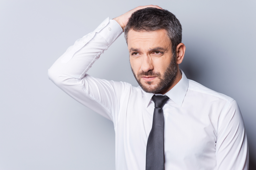 man with beard worried and thinking