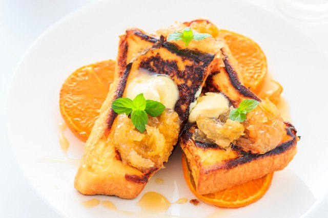 Grench toast with sliced oranges and butter