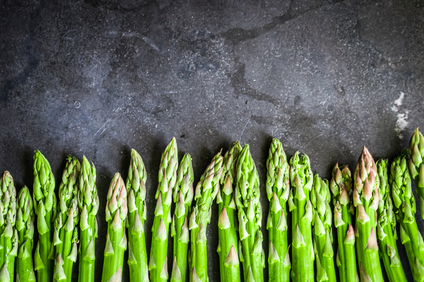 pile of fresh asparagus, ready to be turned into asparagus recipes