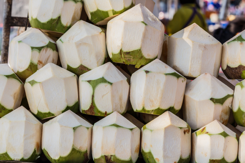 stack of freshly cut young Thai coconuts