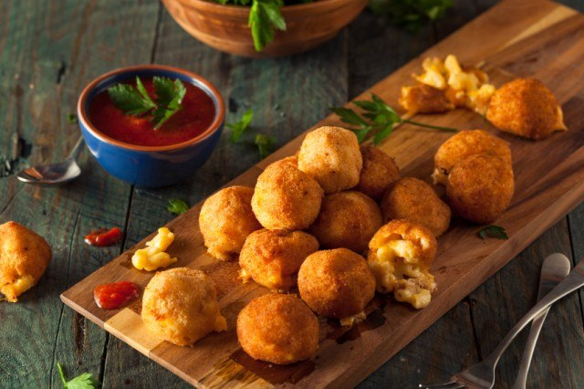 breaded, fried balls of macaroni and cheese with dipping sauce