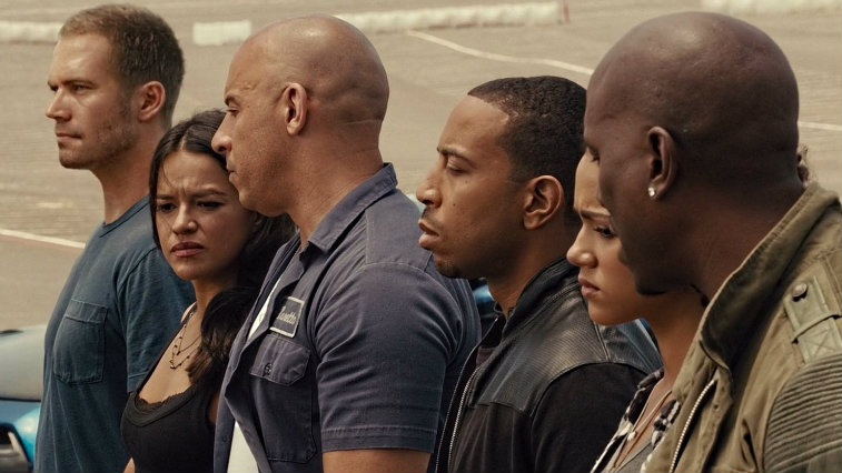 The cast of Furious 7 stands in line looking somber