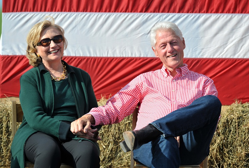 Bill and Hillary Clinton holding hands at a steak fry in Iowa