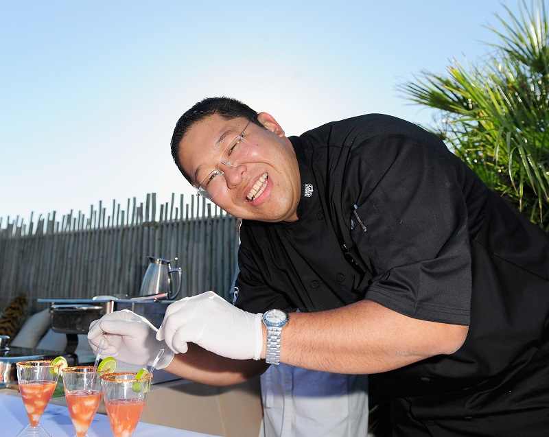 A chef happily at work