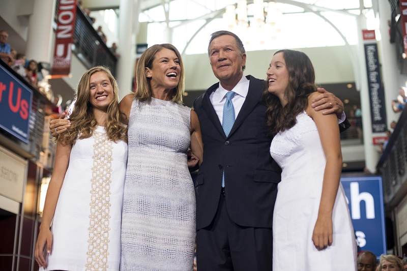 Ohio Governor John Kasich stands with his wife Karen (left center) and his daughters Emma (Blonde hair) and Reese (brown hair) after giving his speech announcing his 2016 Presidential candidacy at the Ohio Student Union, at The Ohio State University on July 21, 2015 in Columbus, Ohio. Kasich became the 16th candidate to officially enter the race for the Republican presidential nomination